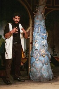 "Ensemble member Tommy Malouf in a scene from ""Christmas Mubarak."" Photo by Airan Wright/Silk Road Rising"