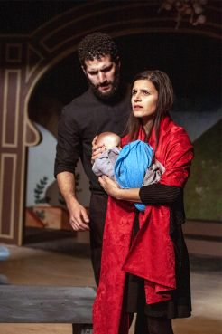 "Ensemble members Tommy Malouf, left, and Annelyse Ahmad perform a scene portraying Mary, Joseph and baby Jesus in the Silk Road Rising production of ""Christmas Mubarak"" at the Chicago Temple in Chicago. Photo by Airan Wright/Silk Road Rising"